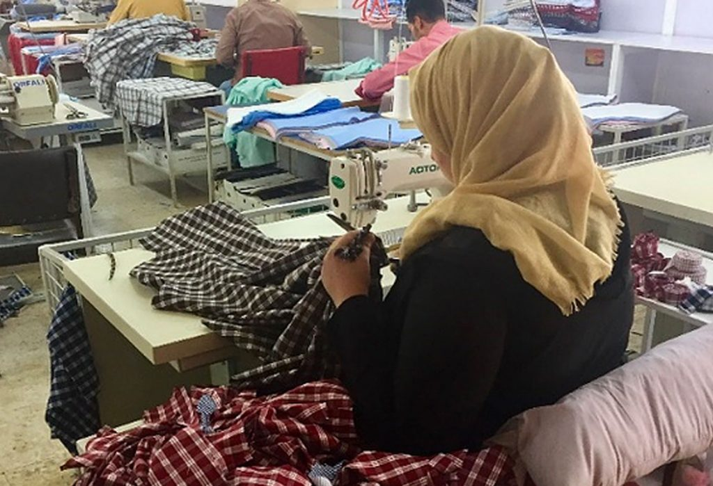 Woman working at sewing machine