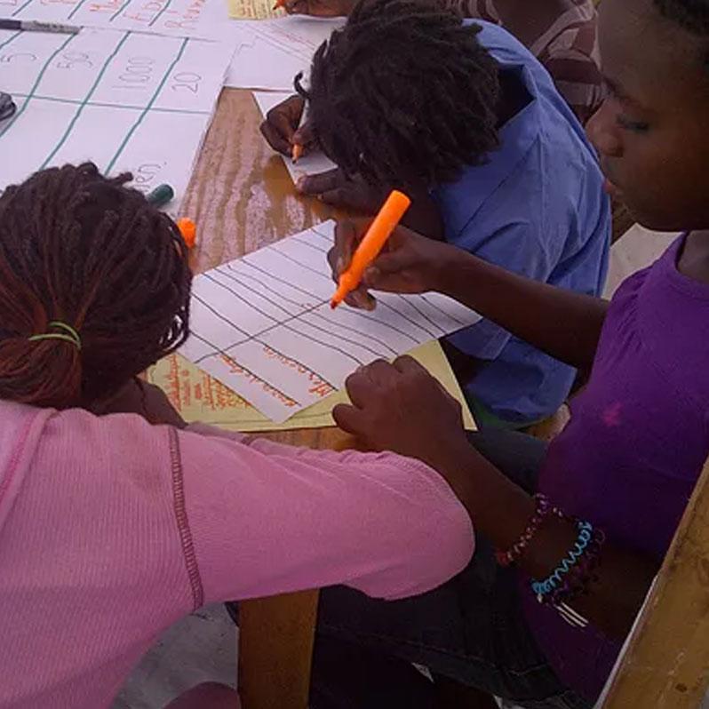 Three girls writing