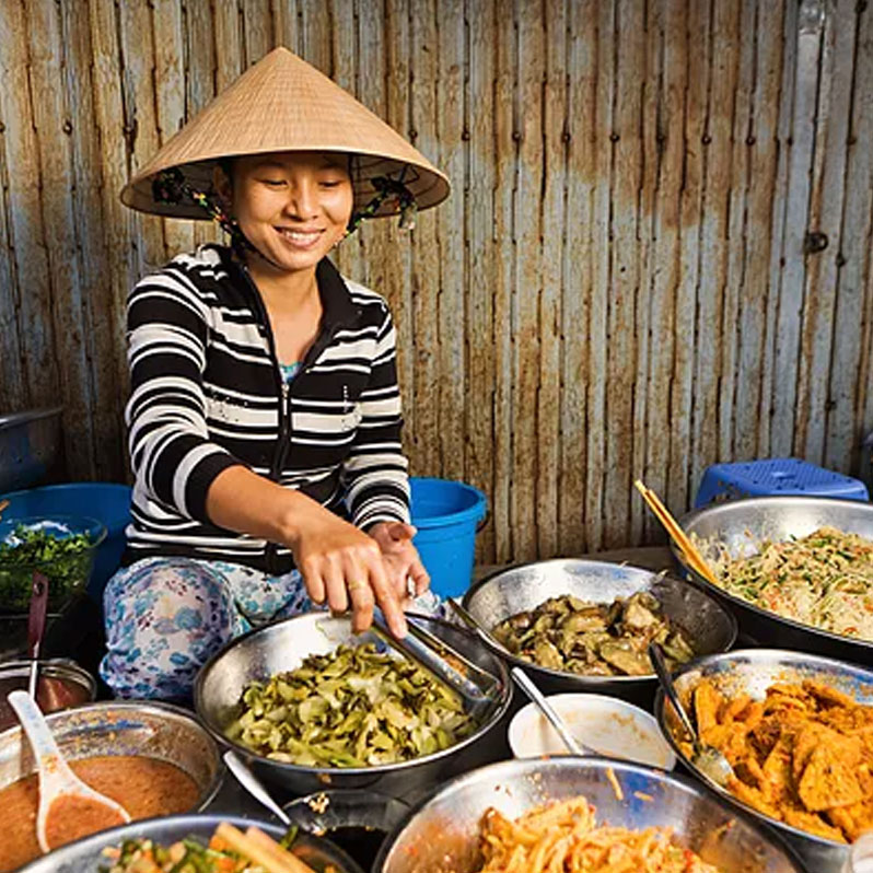 Woman serving food from multiple bowls