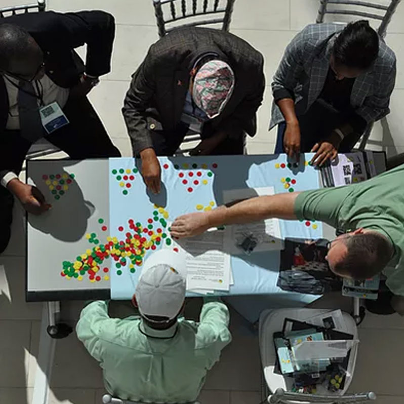 People gathered around table playing game