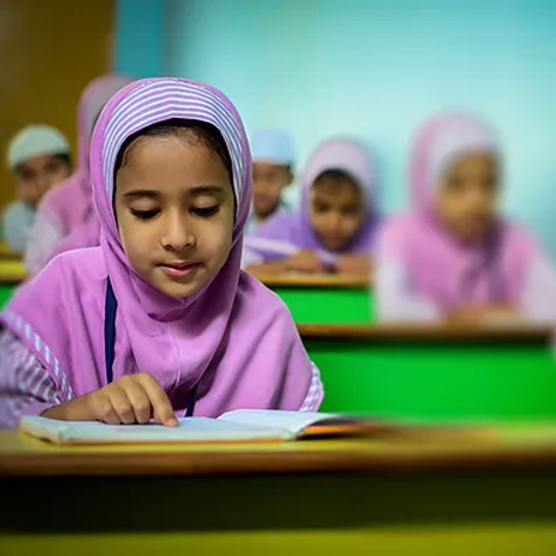 girls reading in classroom