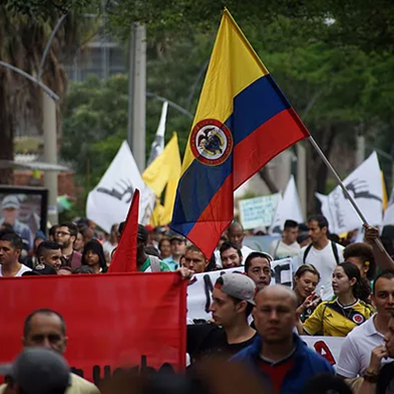 crowd of people marching in Colombia