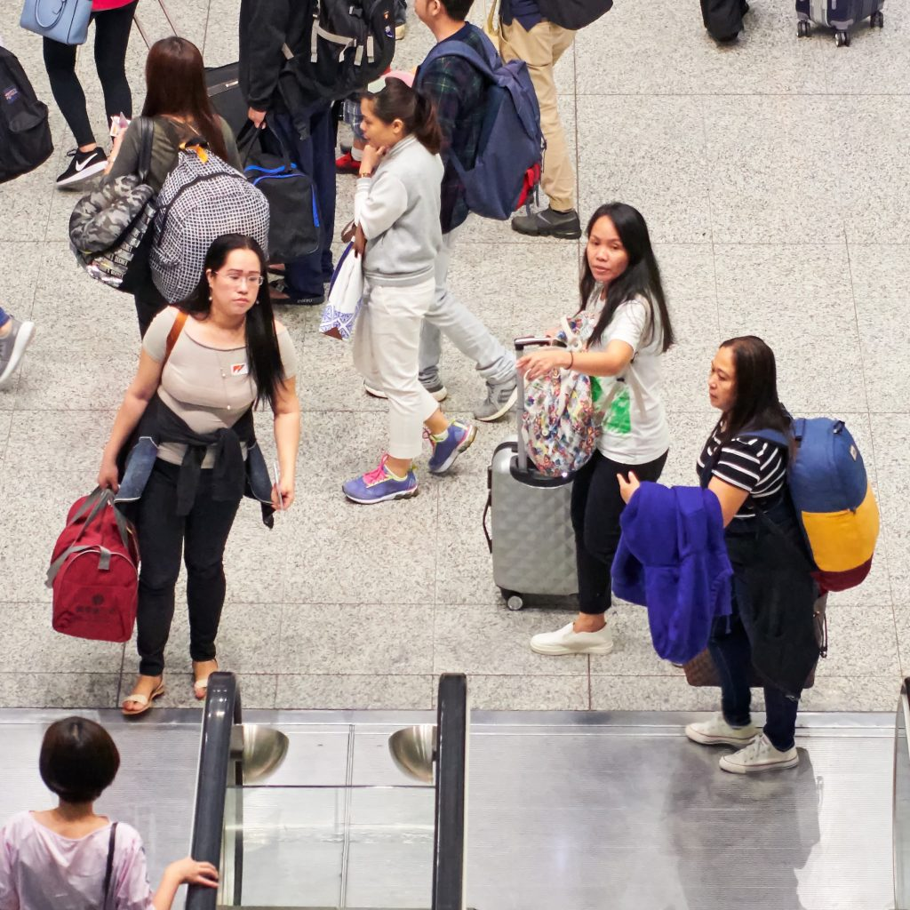Asian Women in an Airport with Luggage